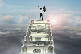 businessman cheer on top of money stairs with natural sunlight cloudscape background