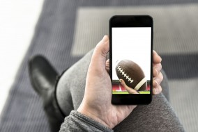 Employees who play Fantasy Football on their mobile devices can potentially put companies at risk.