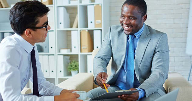 A salesman pitching a product to a businessman.