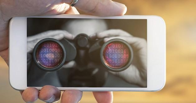 A man looks through binoculars on a smartphone screen.