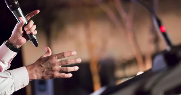 A speaker delivering a presentation at a conference.