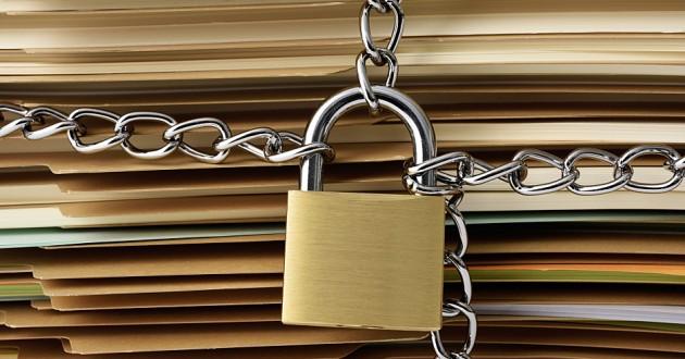 A padlock locking paper files.