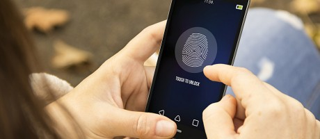 A smartphone user logs into a mobile device using fingerprint authentication.