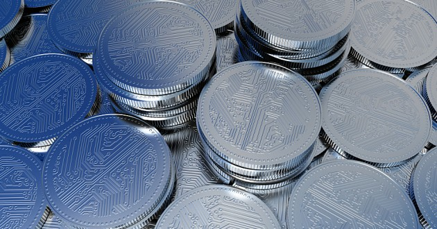 Digital cryptocurrency stacked on a surface.