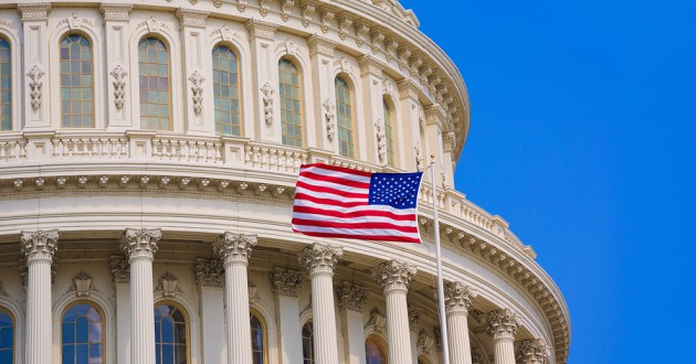 An American flag waving outside the U.S. Capitol building.