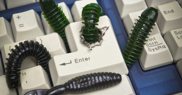 Rubber worms on a computer keyboard.