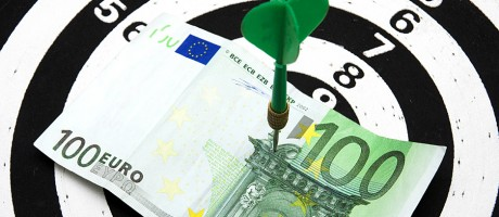 100 euros pinned to a dartboard.