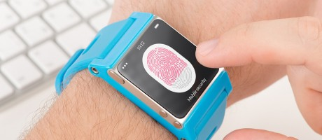 A mobile user submitting a fingerprint for authentication on a smartwatch.