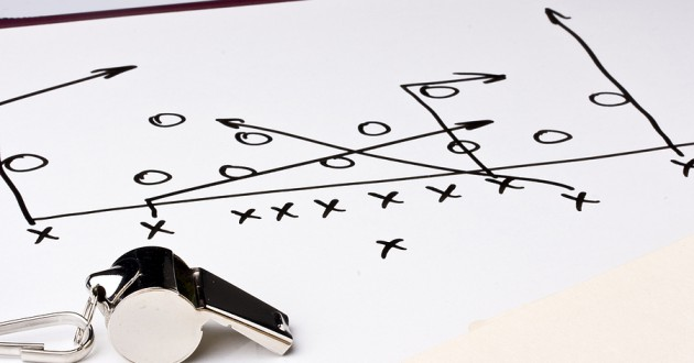 A diagram of a football play next to a whistle.