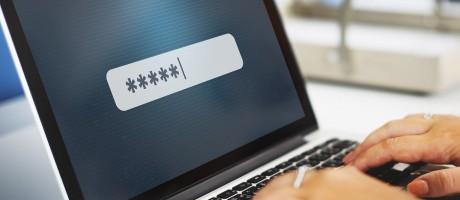 A laptop user entering a password.