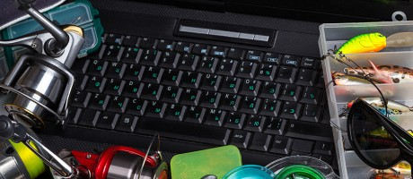 Fishing tackle on a computer keyboard.