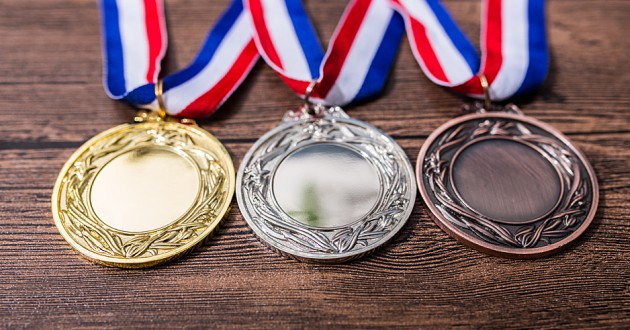 Medals for the top three finishers laying on a table.
