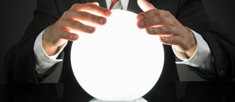 A businessman rubbing a crystal ball.
