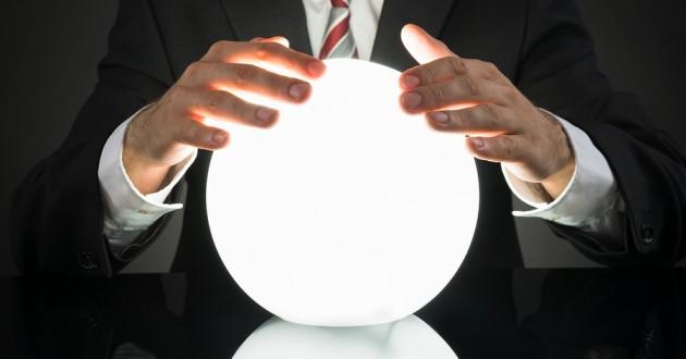 A businessman rubbing a crystal ball.