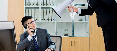 A business executive communicating ineffectively with a staff member.