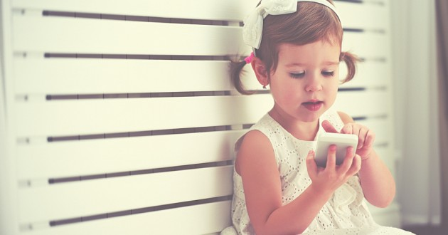 A small child using a smartphone.