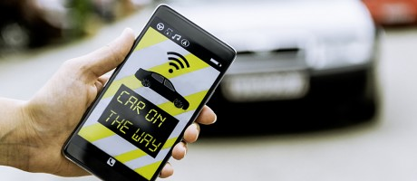 A smartphone user requesting a car through a ride-sharing app.