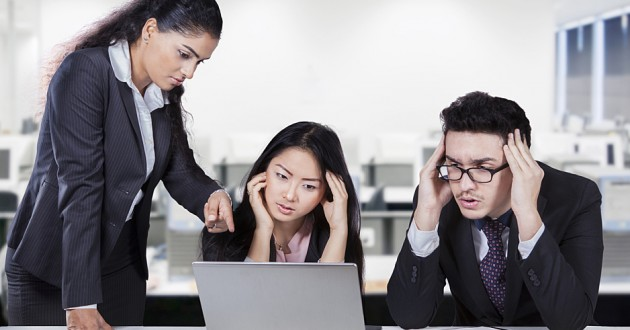 Female manager showing the workers mistake.