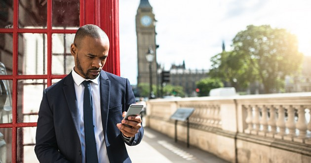A businessman using a smartphone in London.