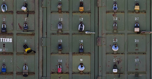 Small lockers with a variety of old locks securing them.