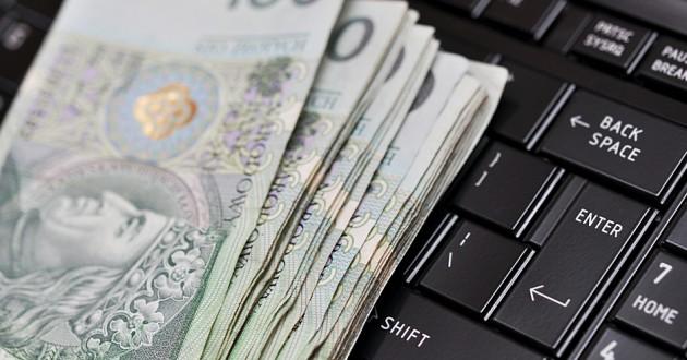 Polish money on a keyboard.