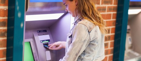 Woman using an ATM kiosk.