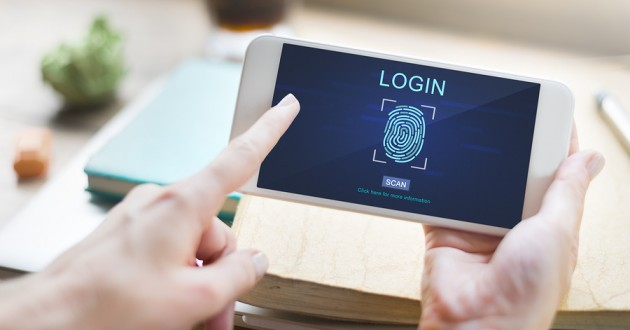 A smartphone user entering a fingerprint for biometric authentication.