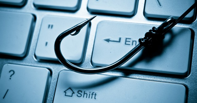 A fishing hook over a keyboard.
