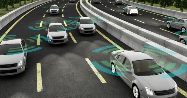 Autonomous cars driving on a road.