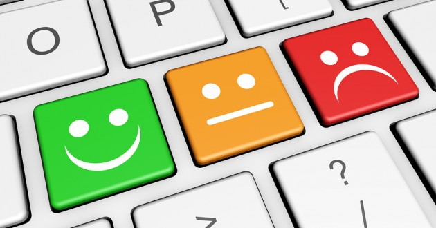 Survey keys with smiling face symbols on a computer keyboard.