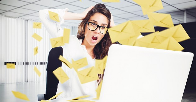 A businesswoman overwhelmed with spam email.