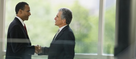 Two business executives shaking hands.