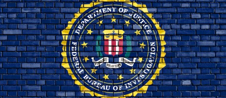 The FBI logo on a brick background.