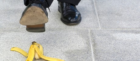 A businessman about to step on a banana peel.