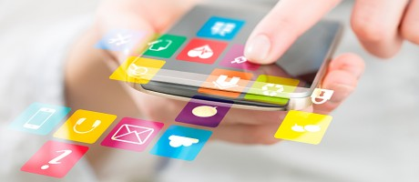 Apps popping out of a mobile phone.