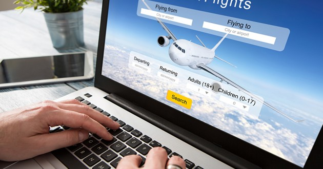 A laptop user booking a flight on an airline's website.