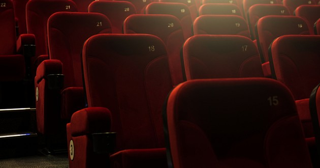Rows of chairs in a theater.