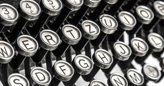 Closeup of typewriter keys that display Latin characters.