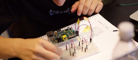 A student programming with a Raspberry Pi.