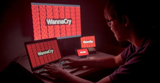 WannaCry ransomware attack on a desktop screen, notebook and smartphone.