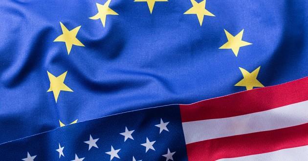 An EU flag above a U.S. flag.