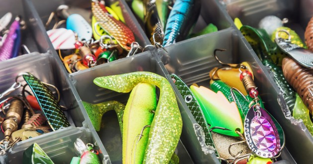 Fishing lures in a tackle box.