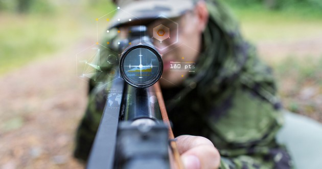A solider looking through the scope of a futuristic weapon.