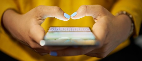 A smartphone user typing a message.