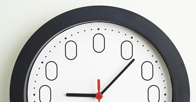 A wall clock with displaying zeroes.