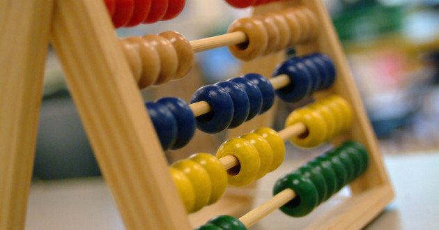A child's abacus on a table.