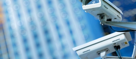Two security cameras mounted on a building.