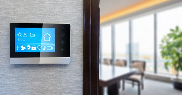 A connected thermostat in a modern office.
