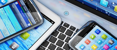 A laptop, tablet and two smartphones displaying application icons.