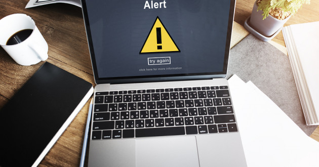 A laptop screen showing a large alert page.
